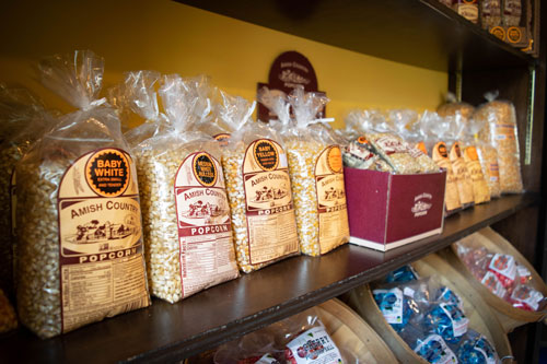 Amish Country popcorn kernels on shelf.